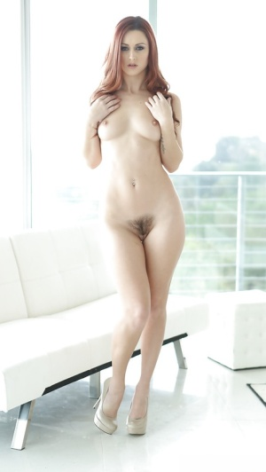 Slender redhead Karlie Montana removes underthings to dash about naked
