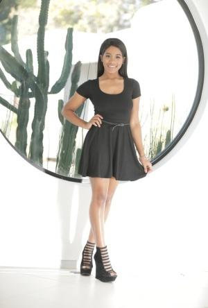 Top ebony model Jenna Foxx strops off her black dress for nude posing