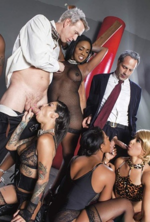 Black and white chicks in kinky fetish attire get busy during group sex