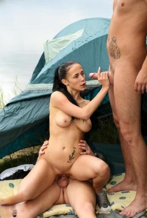 Brunette female Nicole Love fucks 2 of her friends on a camping trip