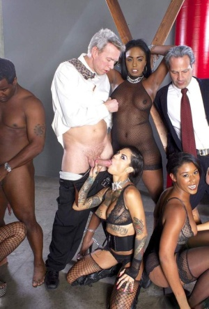 A group of pornstars bang a judge and his boy during group sex