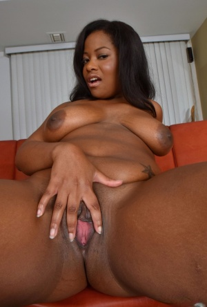 Black amateur sticks out her tongue prior to exhibiting her pink pussy