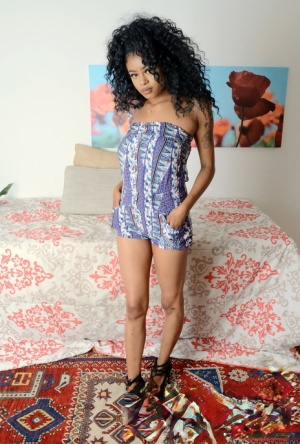 Sexy ebony chick Lala Camile makes her nude modelling debut in her bedroom