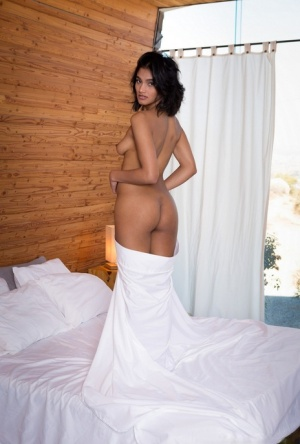 Solo model Angel Constance works free of her clothes for Playboy spread
