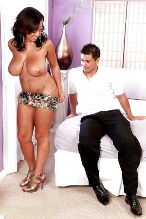 Very elegant BBW lady Natasha Dulce shopws off her big ebony jugs in very slutty dress and high heels.