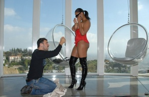 Big titted black babe Alia Starr fucks in a red corset and boots