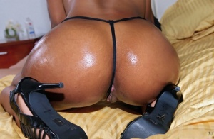Lovely Haze gets her black ass oiled up and her pussy dicked