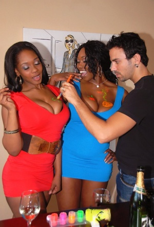 Slutty ebony babes with big tits are into groupsex with face sitting