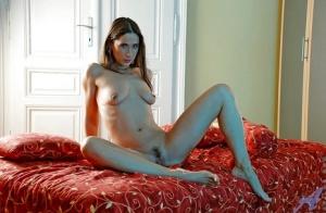 Seductive mature bird in hot lingerie caught spreading her sexy legs.