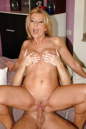 Filthy mature blonde gets a facial cumshot after hardcore fucking