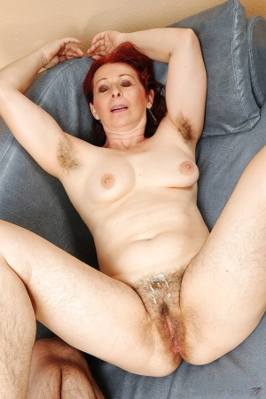 Redhead mature lady with hairy armpits gets her shaggy cunt nailed