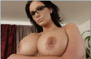 Ravishing MILF in glasses Phoenix Marie stripping off her clothes