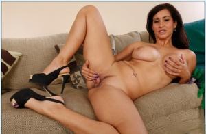Dazzling Latin milf Isis Love posing stripped on high heels