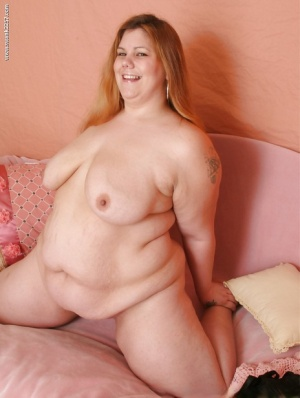 Lusty plumper with flabby boobs stripping and spreading her legs