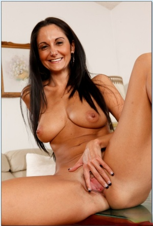 Graceful MILF on high heels Ava Addams stripping and spreading her legs