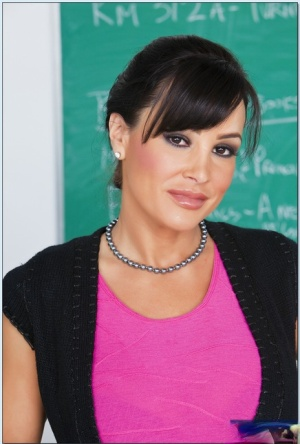 Hot teacher Lisa Ann brings out her MILF boobs and posing in stockings