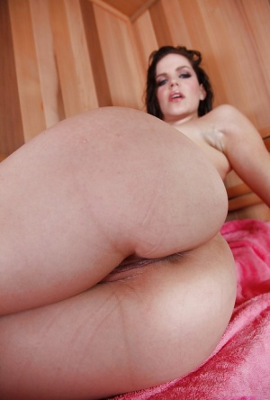 Sexy MILF with long legs Bobbi Starr posing naked and toying her asshole