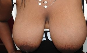 Chubby ebony lady with ample ass revealing her massive flabby melons