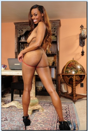 Smiley ebony vixen Tori Taylor gets rid of her dress and red lingerie