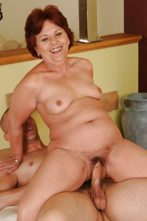 Salacious granny fucks a younger lad and gets her bush glazed with cum