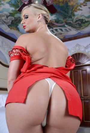 Curvy MILF in fancy red dress Phoenix Marie undressing and posing nude