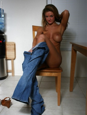 Busty babe Faith Taylor undressing and spreading her slender legs