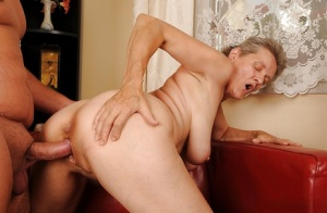 Lecherous granny fucks a younger guy and gets jizzed over her smiley face