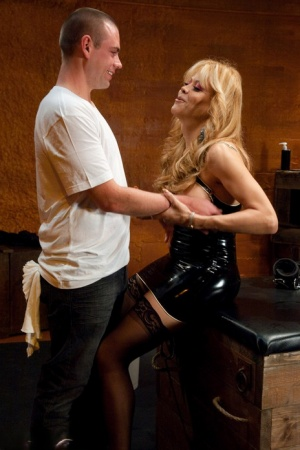 Kinky blonde shemale Johanna B jerking a guy off with her feet