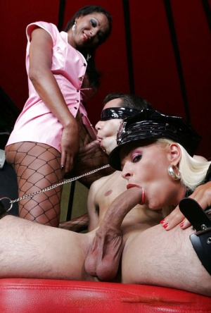 Hot blonde policewoman and a shemale spit roast a man and fill him with cum