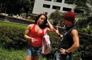 Busty Latina tranny Joyce Naturelle taking big cumshot on pierced tongue