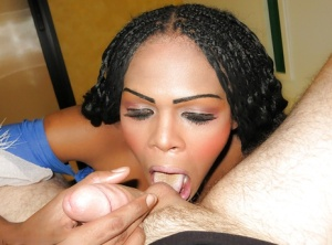 Black and beautiful tranny wearing white stockings sucks huge cock