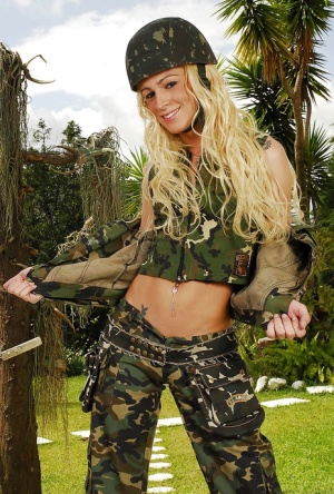 Tranny Dany De Castro makes a hot striptease in an army uniform