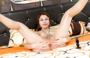 Kinky ladyboy Grace wears a pair of funky glasses while toying asshole