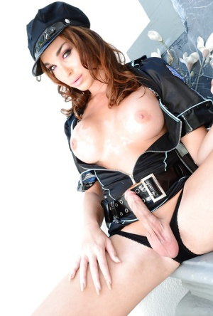 Asian tranny Jonelle Brooks whips out big cock from under police uniform