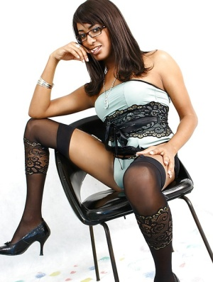 Nerdy Latina tarnny Jessica Campbell modeling solo in glasses and stockings