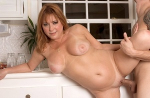 Mature woman's experienced shaved pussy fucked hard in the kitchen