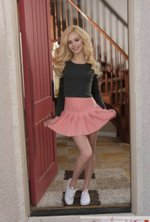 Cute blonde teen Elsa Jean bares her tiny tits while getting naked