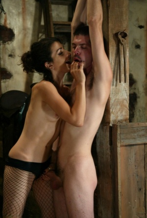 Dominatrix Kitty treats suspended male sub to cbt and orgasm denial