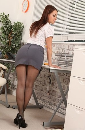 Seductive secretary Kristina doffs her work clothes & poses in sheer pantyhose