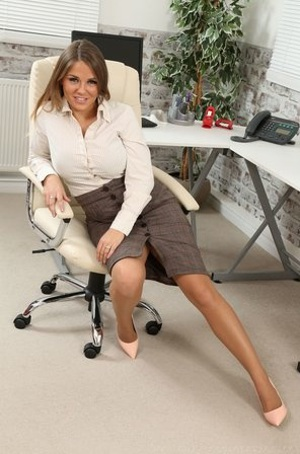 Hot secretary Siobhan Graves in nylon stockings takes off her skirt at office