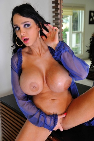 Hot mom Amy Anderssen titty fucks a big cock with her big fake tits before sex