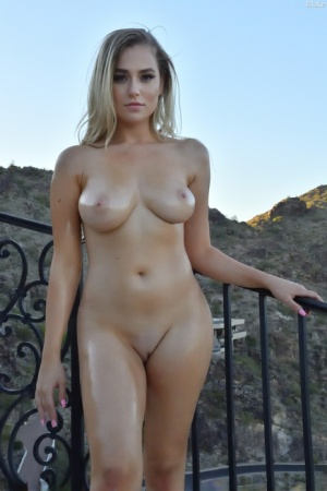 Blue-eyed babe Blake shows off her gorgeous oiled body & toys herself outdoors
