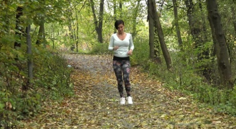 Female jogger Gabriellla Gucci pulls down her leggings for a pee in the woods