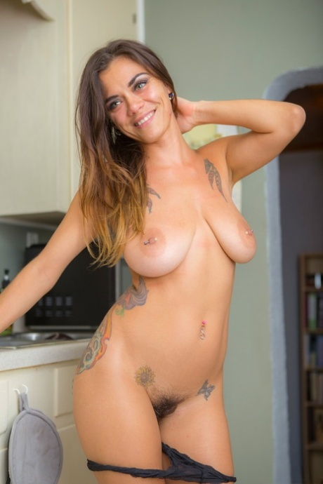 Tattooed slut Veronica Buleau strips off in the kitchen showing saggy bobs