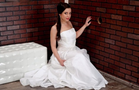 Solo girl in a wedding dress gets plastered with sperm while at a gloryhole