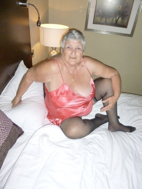 Horny old Grandma Libby strips satin lingerie to fill face & pussy with cock