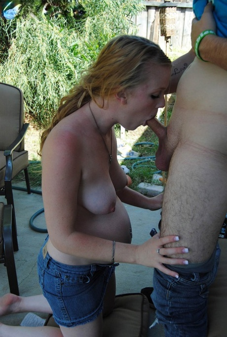 Natural redhead Hydii May sucks the cum from a dick while pregnant
