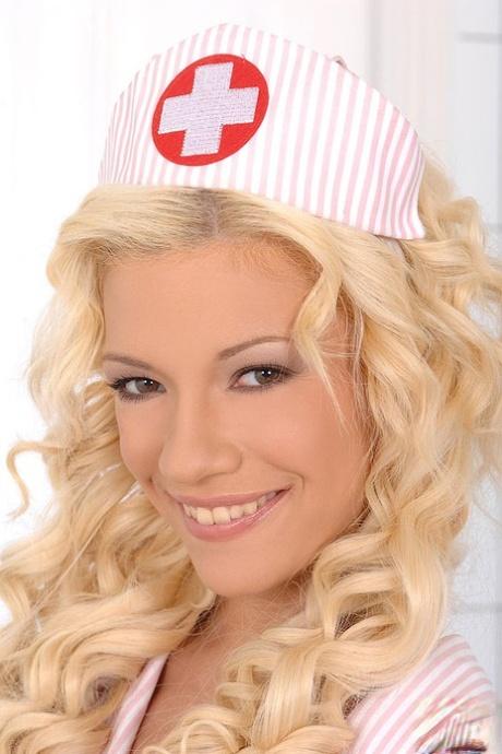 Blonde uniform clad nurse Bibi Noel taking cumshot in mouth after giving bj