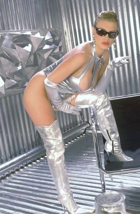 Vintage slut Brittany Andrews in silver lingerie & boots frees big tits to toy