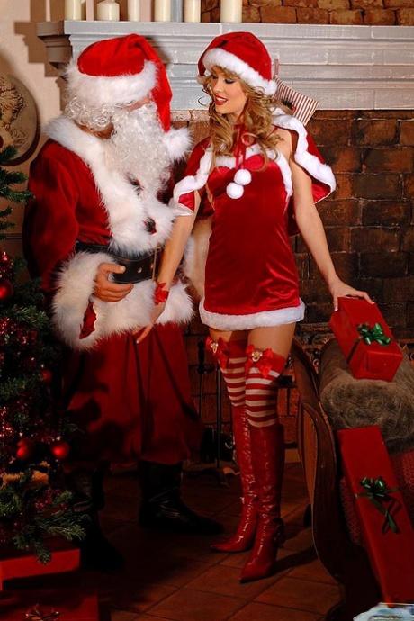 Long sock attired Blue Angel giving Santa's big cock a bj for Christmas